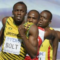 World's fastest man: Usain Bolt competes in the 200-meter heats on Friday in Moscow. | KYODO