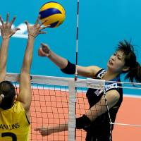 Last line of defense: Japan captain Saori Kimura's attack is blocked by Brazil's Danielle Lins during the FIVB Women's World Grand Prix finals on Thursday in Sapporo. Brazil topped Japan in straight sets, winning 25-21, 25-22, 25-17. | FIVB