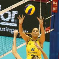 Working together: Brazil's Danielle Lins sets the ball to teammate Thaisa Menezes during Thursday's match again Japan. | FIVB
