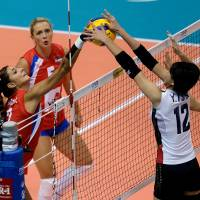 Ball control: Serbia's Jovana Brakocevic (left) and Japan's Yuki Ishii (12) and Aimi Kawashima compete for a point in the FIVB Women's World Grand Prix Finals on Friday in Sapporo. Serbia defeated Japan 25-22, 25-17, 25-19. | FIVB