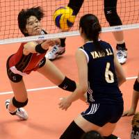 Strong effort: Japan's Haruka Miyashita keeps the ball in play against China during Saturday's FIVB Women's World Grand Prix Finals match in Sapporo. China beat Japan in a five-game match. | FIVB