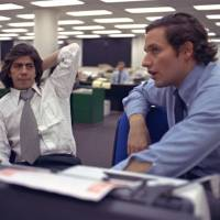 Star newshounds: Journalists Bob  Woodward (right) and Carl Bernstein, whose reporting of the Watergate scandal won them a Pulitzer Prize, sit in the  Washington Post newsroom in May 1973. | AP