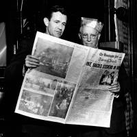 Hot off the press: Philip Graham (left) and Eugene Meyer look at the first-ever copy of  The Washington Post  Times Herald, in Washington on March 18, 1954. | AP