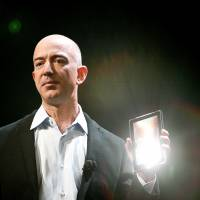 Trailblazer: Amazon CEO Jeff Bezos unveils a Kindle Fire tablet at a news conference in New  York in September 2011. | BLOOMBERG