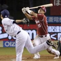 Significant contribution: Ginji Akaminai belts a go-ahead home run in the eighth inning against the Lions on Friday at Seibu Dome.   |  KYODO