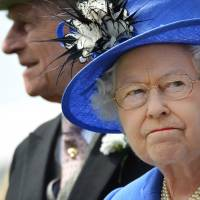 One each way: Queen Elizabeth II and Prince Philip attend the Epsom Derby horse race in Epsom, England, in June 2012. | AP