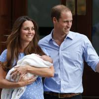 Middle-class heroes: The Duke and Duchess of Cambridge hold their son, Prince George of Cambridge, outside a London hospital on July 23, a day after his birth. The royal couple's seemingly down-to-earth lifestyle has won them many fans. | AP