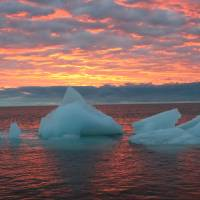 Cold comfort: Ice chunks float in the Arctic Ocean as the sun sets near Barrow, Alaska, in September 2006. Scientists report ice in the region is melting at an alarming rate. | AP