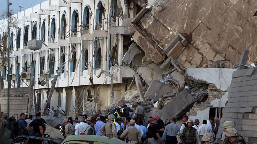 Shock waves: U.S. soldiers and relief workers stand outside the devastated Canal Hotel in Baghdad on Aug. 19, 2003.