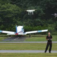 Flights of fancy: A man pilots his aircraft as local drone enthusiasts gather for the Maryland Fly In last month in Laytonsville. | THE WASHINGTON POST