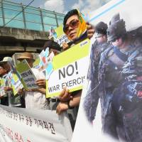 Exercise in free speech: Protesters stage a rally against joint South Korea-U.S. Ulchi Freedom Guardian military exercises in front of the U.S. Army garrison in Yongsan, Seoul, on Monday. | AP