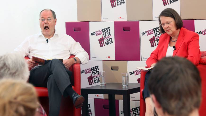 The soft sell:  The Social Democratic Party's candidate for chancellor, Peer Steinbrueck, and his wife, Gertrud, read a chapter from the children's book 'Jim Knopf' during the Deutschlandfest, which was organized by the SDP in Berlin on Sunday.