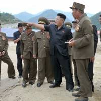 Harsh terrain: North Korean leader Kim Jong Un (center) visits the Masik ski resort construction site in this undated photo. | AFP-JIJI