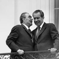 Clemente ties: Soviet leader Leonid Brezhnev whispers in the ear of U.S. President Richard Nixon at the White House in June 1973. | AP
