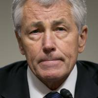 Talking tough: Defense Secretary Chuck Hagel has suggested U.S. forces were being moved ahead of any possible decision on taking action in Syria. | BLOOMBERG