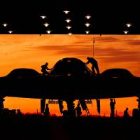 Waiting in the wings: Hangar crew work on a B-2 stealth bomber at  Whiteman Air Force Base in Missouri City,  Texas, in May. | AFP-JIJI