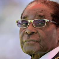 Man who used Mugabe poster in toilet charged
