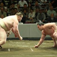 Former ozeki Baruto (left) takes on yokozuna Hakuho during a 2012 training session. | MARK BUCKTON
