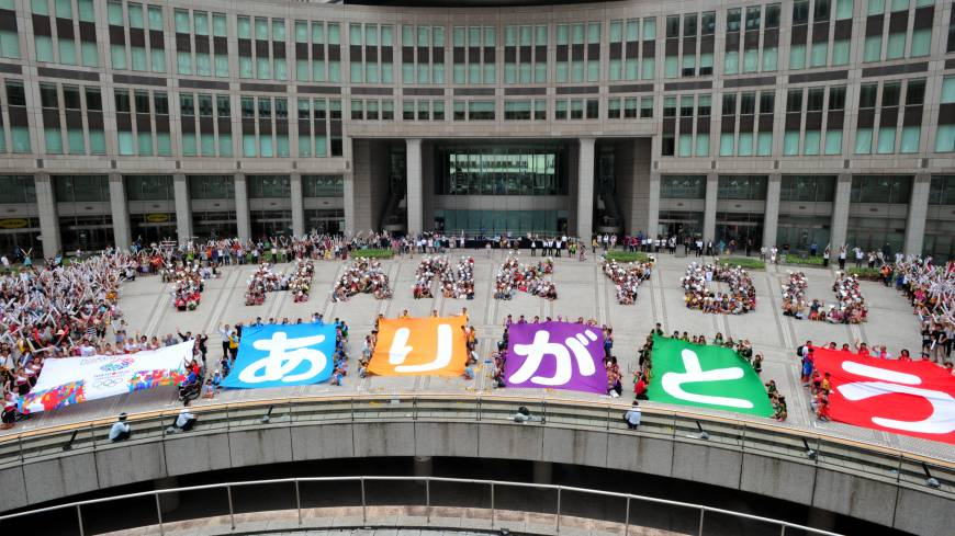 Gratitude: About 600 people spell out 'Thank You' in front of the Tokyo Metropolitan Government Building in Shinjuku Ward Sunday morning after it was announced that Tokyo would host the 2020 Olympics and Paralympics.