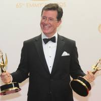 Stephen Colbert holds Emmys for Best Writing for a Variety Series Award and the Variety Series Award for 'The Colbert Report.' | AFP-Jiji