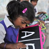 AB sea change: Schoolchildren practice English at a primary school in Hyderabad on June 13. Over 200 languages have died out in India in the last 50 years, according to a new study. | AFP-JIJI