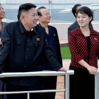 Business of pleasure: North Korean leader Kim Jong Un, accompanied by his wife, Ri Sol Ju, inspects the Rungna People's Pleasure Ground in Pyongyang last year. | AP