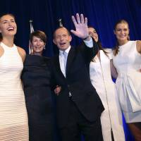 New boss: Australian Prime Minister-elect Tony Abbott celebrates his election victory in Sydney on Saturday evening with daughters Frances (left), Louise (second from right), Bridget (right) and Margaret, his wife. | AP