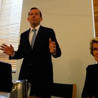 New man: Australian Prime Minister-elect Tony Abbot (center) speaks to newly elected members along with the deputy leader of the Liberal Party, Julie Bishop (right), and National Party leader Warren Truss at Parliament House in Canberra on Friday. | AFP-JIJI