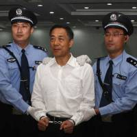 Fallen star: Bo Xilai stands in a courtroom in Jinan, China, on Sunday, when he was sentenced to life in prison. | AFP-JIJI