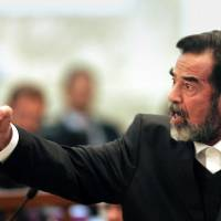 'Keen to adopt our product': Former Iraqi President Saddam Hussein points during his 2006 trial in Baghdad. | AP