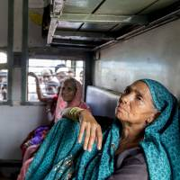 Male-free zone: Friends sit in a women-only carriage on a train from New Delhi's Nizamuddin Station bound for Gondwana in Maharashtra state on Sept. 19. | THE WASHINGTON POST