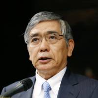 Talking it up: Bank of Japan Gov. Haruhiko Kuroda speaks in Tokyo on Friday.   | KYODO