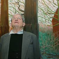 Definitive?: David Hockney stands in front of his painting 'Bigger Trees Near Warter,' a work whose inclusion in a new art survey is questioned by the reviewer. | BLOOMBERG