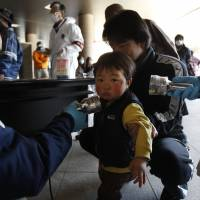 Fears for the future: A child is screened for radiation shortly after the accident at Fukushima No.1 nuclear power plant in 2011. Fukushima Medical School continues to monitor some 360,000 under-18s for signs of cancer. | AP