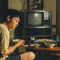 Like father, like son: Toma (Masaki Suda) lives with his father (Ken Mitsuishi) — and learns from him a habit of sexual violence. | © Tanaka Shinya/Kodansha 2013