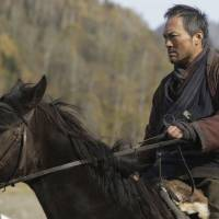 Fistful of yen: Ken Watanabe takes the Clint Eastwood role of a retired troublemaker back for one last bounty in 'Yurusarezaru Mono,' a remake of Eastwood's 1992 movie 'Unforgiven.' © 2013 Warner Entertainment Japan Inc. | KAORI SHOJI