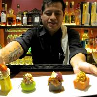 Counter service: Bepocah is not Tokyo's first Peruvian restaurant, but it is perhaps the first to serve authentic Peruvian food in a setting tailored to Japanese tastes. Dishes include inventive causas (mashed-potato cakes, above). | ROBBIE SWINNERTON