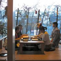 Al fresco fare: With renowned Kyoto chef Hisato Nakahigashi overlooking the kitchen, Shakunage offers fine kaiseki multicourse meals and a stunning outdoor view of central Tokyo — at relatively low prices. | ROBBIE SWINNERTON