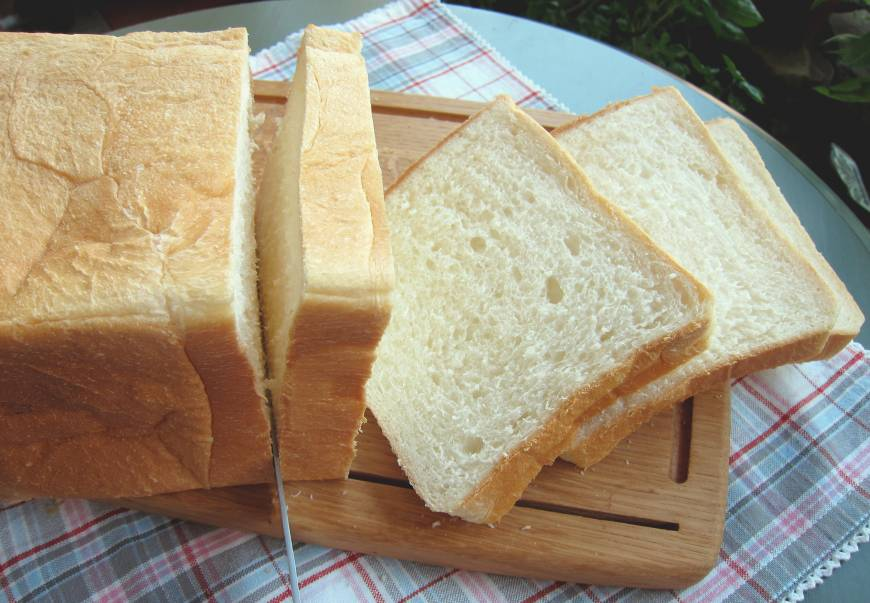 ... Japanese shokupan loaf is usually white and much fluffier than bread