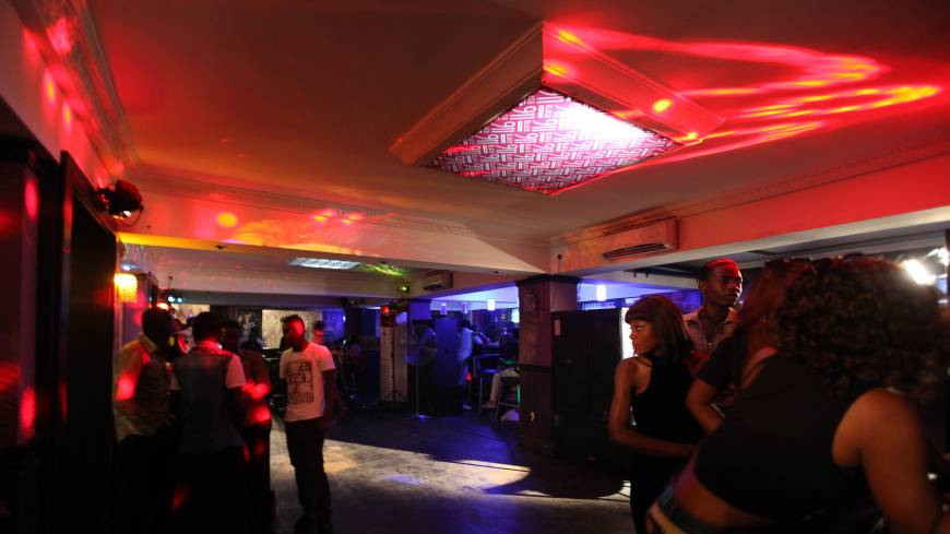 A club reborn: Preparing for a music video shoot in 911 Black, Gilbert Otaigbe's nightclub in Abuja.  Use of the club was offered free of charge in hopes that the video would attract customers.