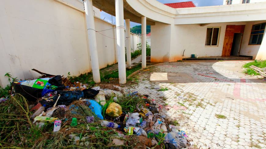 Digs: A courtyard in front of an unfinished apartment where Gilbert Otaigbe houses 911 Black club employees, in the Maitama district of Abuja.