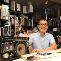 Electronic wiz: Junichi Matsuzaki shows one of 3,000 boomboxes he has collected and stocks at his studio in Adachi Ward, Tokyo. | SATOKO KAWASAKI