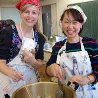 Melting pot:  The writer and a friend make soup for a community event, one of their PTA duties. | COURTESY OF LOUISE GEORGE KITTAKA