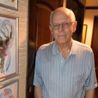 Renaissance man: Dutch writer Hans Brinckmann shows some of his artworks in his Fukuoka home. | STEPHEN MANSFIELD