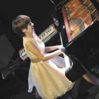 Setting a tone: Ai Kuwabara plays piano at a recent gig with her Trio Project in Yokohama. | MOTION BLUE YOKOHAMA