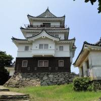 Hirado Castle, pictured right, with one of its old wooden gates left. The castle itself is a reconstruction, but two gates date back to the early 1700s; also on display is a sword nearly 1,500 years old and fascinating woodblock prints. | MANDY BARTOK