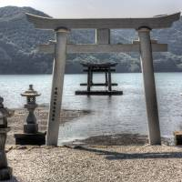 Island welcome: Two of the five torii gates at Watastumi Shrine appear as though floating in the water. | ALON ADIKA