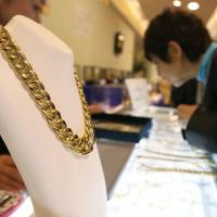 Only the best: A woman shops for gold jewelry at a Matsuzakaya department store in Tokyo in April. Sales of luxury goods are growing at department stores. | BLOOMBERG