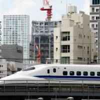 Crowd favorite: A shinkansen speeds through Tokyo on Monday. | AFP-JIJI