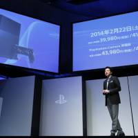 In demand: Hiroshi Kawano, president of Sony Computer Entertainment Japan Asia, holds a news conference in Tokyo on Monday. Sony will release the PlayStation 4 console in Japan three months after it reaches shelves in North America. | BLOOMBERG